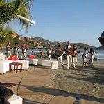 Mariachi arriving after wedding ceremony