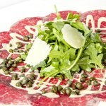 Thinly sliced filet mignon, homemade mustard sauce, arugula and parmegiano regiano
