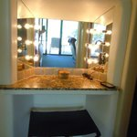 Brightly lit dressing mirror just outside bathroom