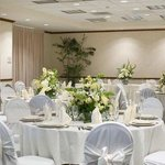 This is a view of our Oaks Ballroom set in rounds of 8 with white linen and chair covers.