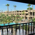 On the restaurant deck, looking back toward the rooms. Ours was between those 2 palms.