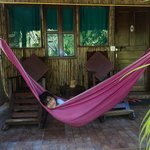 Yanaika relaxes in the Hammock outside the room
