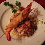 very delicious sea bass and tiger prawn over risotto