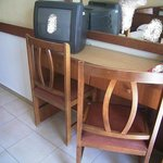  Small old tv. Look also at the furniture.