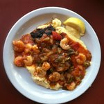 Blackened Grouper over Grits Shrimp and Creole