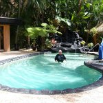  Pool with &quot;volcano waterfall.&quot;  Hot tub is front right of picture