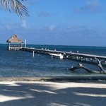 View of the beach, dock and palapa