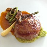 Lamb crepinette (sausage) with fiddlehead ferns