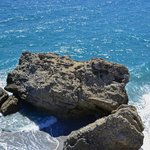 View of the rocks and Mediterranean Sea just underneat the tip of Balcon de Europa