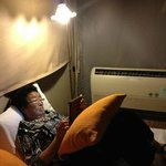  My mother relaxing with her IPAD in the tent