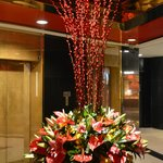 Flower arrangement in elevator area.