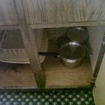 Under the sink. Somebody put the dishrack back wet!