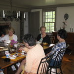 Women on a getaway weekend enjoy breakfast in the keeping roon