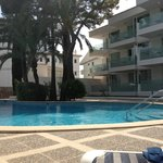 View of apartment block from pool