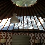 inside view of the yurt, window above cranks open if desired
