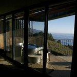 View looking from part of the suite out on to hot tub, hillside and Pacific