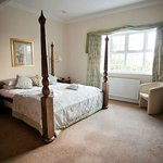 The stunning bridal suite and 4 poster bed. en-suite room with jazui bath