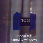Room #'s scoth taped to room windows