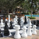 chess game around the swimming pool