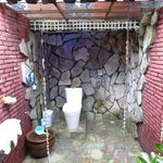 Bathroom with stone walls