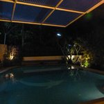Guesthouse at night with pool view