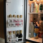 50% of the mini fridge locks. Inside are expensive drinks & snacks