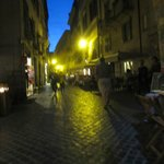 Busy night scene outside Navona Gallery and Garden Suites