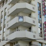 Pictures of the King and Queen posted on the balconies of the hotel