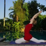 Yoga session near the pool