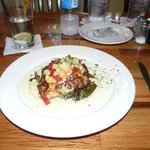 Nightly seafood special - Snapper on top of grits and greens
