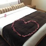 It was our anniversary and they put a rose petals heart on our bed. Sweet!!