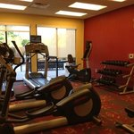 workout room has towels and water. 2 ellipticals, 2 treadmills, 1 bike and free weights.