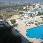 View over the swimming pool and the valley