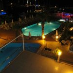 This is a the view from our room of the pool area by night