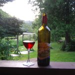 enjoying a glass of local wine from our cabin