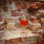 Set my spritz down in a little alcove of the building next to the bar.