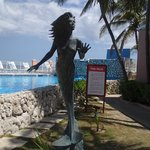 Mermaid above water by pool and indoor resturant