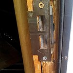 after the door had apparently been kicked in, the latch plate had been moved back, causing a gap