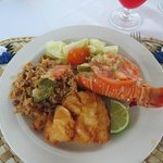 Fried Hog Fish, lobster tail, beans & rice, and cassava & cabbage