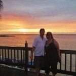 Me and hubby by beach at sunset