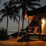 My wife watching the full moon rise over the ocean from our cabana