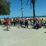 the beach outside of hotel a brass band