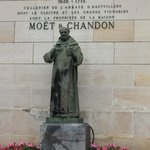 In the courtyard - a statue of Dom Perignon