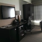 large desk, flat screen tv, bar fridge and microwave included