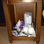 tea & coffee thrown into bottom of bedside cabinet with door missing