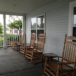 rocking chairs in front of hotel