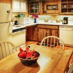 Deer Haven has a full kitchen with a stove, refrigerator, microwave, dishwasher, a table and cha