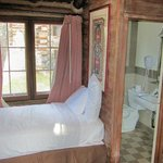 Twin bed and bathroom