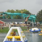 Awesome swim pond with tons of inflatables, pool in background