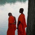 Young monks by the water